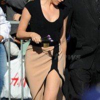 Windswept Amber Heard nearly flashes a bit too much wearing a revealing Michael Kors dress, LA